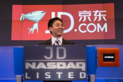 JD.com CEO and founder Richard Liu speaks to employees during the company's initial public offering (IPO) on NASDAW in 2014 in New York City.