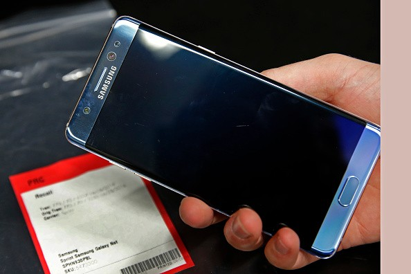 A Samsung Galaxy Note 7 is held up with other Note 7 phones on a counter that were returned to a Best Buy on Sept. 15, 2016 in Orem, Utah.