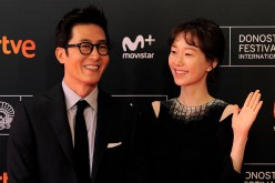 South Korean actor Kim Joohyuck (L) and actress Lee Yoo-Young (R) pose during a photocall after the screening of their film 'Dangsinjasingwa Dangsinui Geot' (Yourself and Yours) at the 64th San Sebastian Film Festival, in the northern Spanish Basque city