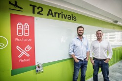 Maximilian Bittner, chief executive officer of Lazada Group SA, and Roger Egan, co-founder and chief executive officer of RedMart, pose for a photograph in Singapore.
