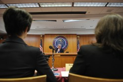 Federal Communications Commission (FCC) Chairman Tom Wheeler speaks as audience watch