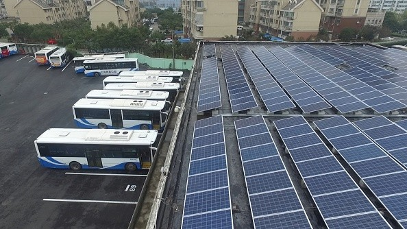 Buses are parked in a parking building powered by solar energy in Shanghai.