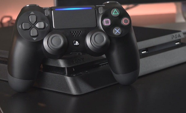 PS4 Slim along with controller for console.