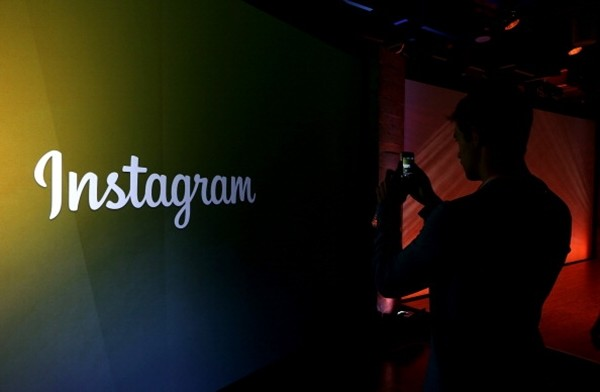 An attendee takes a photo of the instagram logo during a press event at Facebook headquarters on June 20, 2013 in Menlo Park, California. Facebook announced that its photo-sharing subsidiary Instagram will now allow users to take and share video.