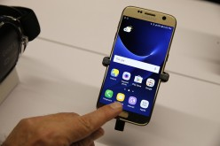A user checks Samsung Galaxy S7 smartphone