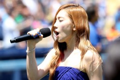 Taeyeon of sings the Korean national anthen during Korea Day ceremonies before the game between the Cincinnati Reds and the Los Angeles Dodgers at Dodger Stadium on July 28, 2013 in Los Angeles, California.