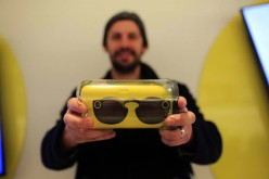 A customer shows a pair of Snapchat Spectacles, a pair of camera-equipped sunglasses made by Snapchat Inc.