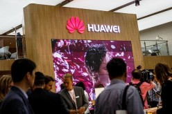 Visitors passing the stand of Huawei at the 2016 IFA consumer electronics trade fair on Sept. 2, 2016 in Berlin, Germany.
