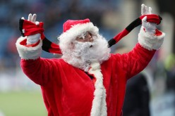 A man dressed up as Santa Claus spotted during a football match in the Scottish Premier League.
