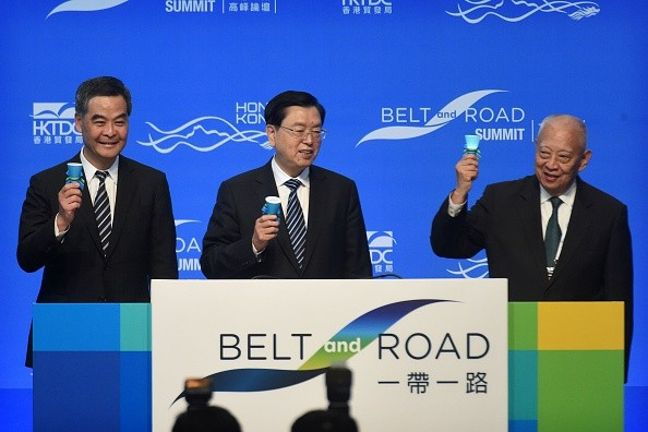 Hong Kong Chief Executive Leung Chun-ying (L), Zhang Dejiang (C) and former Hong Kong chief executive Tung Chee-hwa (R) open the Belt and Road Summit in Hong Kong on May 18, 2016.
