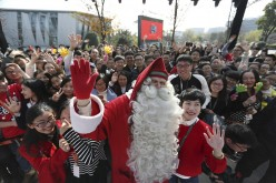 The official Santa Claus, authorized by the United Nations, appears at the campus of Chinese e-commerce powerhouse Alibaba in Hangzhou, Zhejiang Province, on Friday, Dec. 23, 2016.