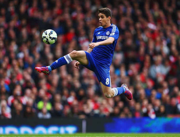 Oscar, then of Chelsea, controls the ball during the Barclays Premier League match against Arsenal.