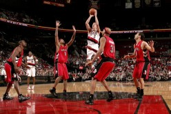 The Portland Trail Blazer's Steve Blake shoots over the Toronto Raptors defence in a tightly contested 96-94 Trail Blazers win back in Jan. 2006.