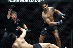 Vincent Latoel lands a strike that takes down Eddie Ng during their encounter at ONE FC 16.