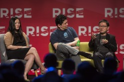 Xing Liu, partner at Sequoia Capital, right, speaks as Anna Fang, partner and chief executive officer of ZhenFund, left, and David Chao, co-founder and general partner of DCM Ventures, listen during the Rise conference in Hong Kong, China, on Tuesday, May