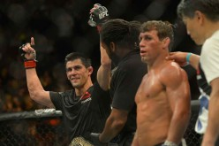Dominick Cruz gets his arm raised by referee Herb Dean after he beat Uriah Faber in their bantamweight championship match held at UFC 199 last June 4, 2016.