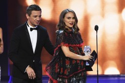 Natalie Portman accepts the award for Best Actress for 'Jackie' from Jeremy Renner onstage during the 22nd Annual Critics' Choice Awards at Barker Hangar on December 11, 2016 in Santa Monica, California.