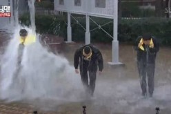'Running Man' producers doused in water as punishment during the Jan. 1 episode of the SBS variety program.