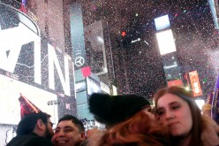 Confetti falls as people celebrate New Year's eve in Times Square in New York City just after midnight on January 01, 2017.