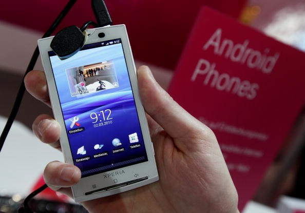 A stand host holds a Sony Ericsson XPERIA X10 mobile phone that uses the Android operating system
