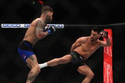 Dominick Cruz lands a leg kick against Cody Garbrandt in their encounter at UFC 2017 last Dec. 30, 2016.