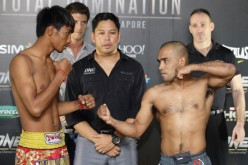 Khim Dhima (L) and Rene Catalan (R) square off during the weigh-ins for ONE: Total Domination last Oct. 17, 2013.