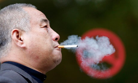 A-man-smokes-next-to-a-No-007.jpg