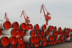 Steel pipes for shipment and export are piled up at Lianyungang Port in Lianyungang, Jiangsu Province.