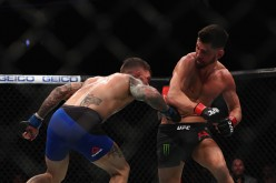 Cody Garbrandt lands a huge body shot against Dominick Cruz at UFC 207 last Dec. 30, 2016.
