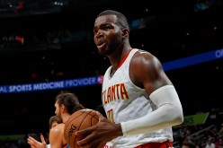 Paul Millsap of the Atlanta Hawks reacts to the referees during the game against the Oklahoma City Thunder at Philips Arena on December 5, 2016 in Atlanta, Georgia.