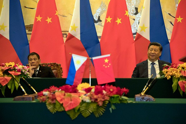 Philippine President Rodrigo Duterte and Chinese President Xi Jinping attend a signing ceremony on Oct. 20, 2016, in Beijing, China.