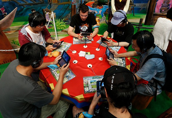 "Gamers play ""Monster Hunter Stories"" on their Nintendo 3DS consoles during the Tokyo Game Show last Sep. 17, 2016."
