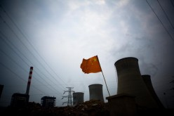 A Chinese flag flies over a coal-fired power plant in China.