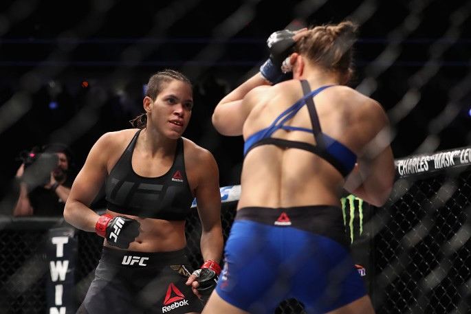 Amanda Nunes of Brazil and Ronda Rousey face off in their UFC women's bantamweight championship bout during the UFC 207 event at T-Mobile Arena on December 30, 2016 in Las Vegas, Nevada.