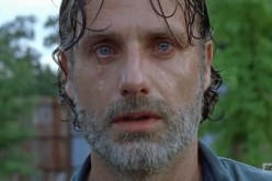 Rick sheds tears as he watches Negan and his group move out of Alexandria in