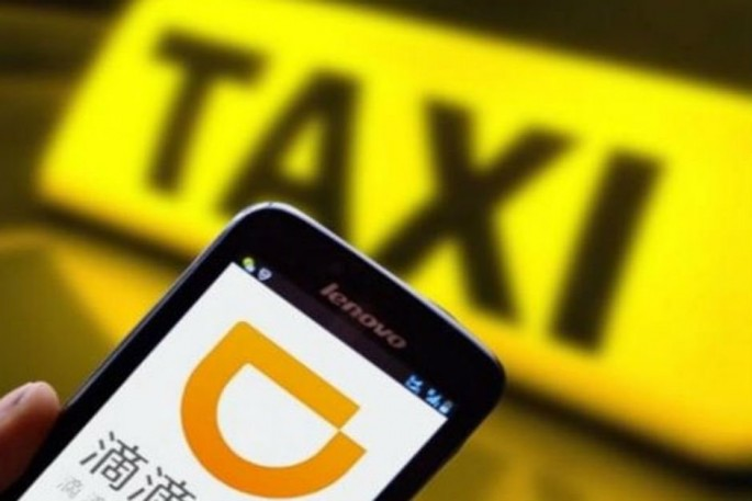 China's Didi Chuxing is investing at least $100 million in the Brazilian ride-sharing company and Uber rival, 99.