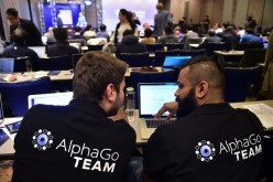 AlphaGo team members sit in a press room for the Google DeepMind Challenge Match at a hotel in Seoul.