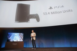 Kazuo Hirai, president and chief executive officer of Sony Corp., stands next to a Sony Sony XBR-A1E Bravia OLED 4K HDR TV while speaking about the PlayStation 4 (PS4) game console during the company's press event at the 2017 Consumer Electronics Show (CE