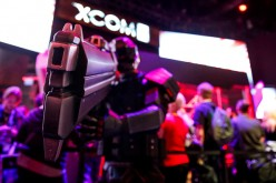 A person dressed as a solider from the X-COM 2 video game poses for a picture during the E3 Electronic Entertainment Expo in Los Angeles, California, U.S., on Tuesday, June 16, 2015.