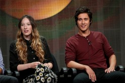 Actors Sophie Lowe (L) and Peter Gadiot speak onstage during the 'Once Upon a Time in Wonderland' panel discussion at the Television Critics Association Summer Press Tour on Aug. 4, 2013.