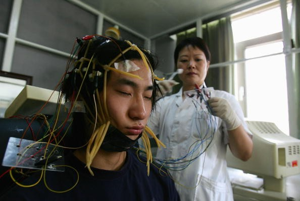 A young Chinese Internet addict receives an electroencephalogram check at the Beijing Military Region Central Hospital.