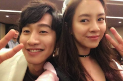 Lee Kwang Soo and Song Ji Hyo take a selfie on the set of the SBS variety show 'Running Man.'