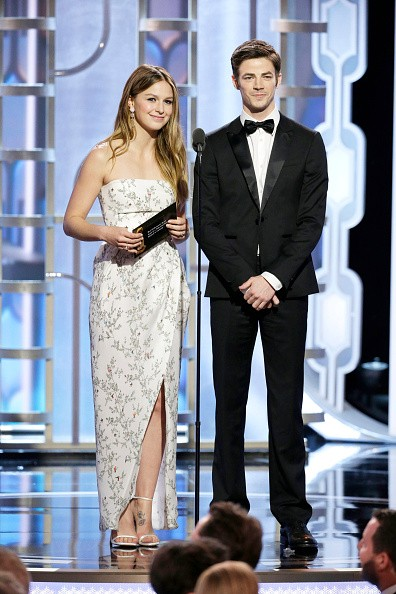 Melissa Benoist and Grant Gustin speak onstage during the 73rd Annual Golden Globe Awards at The Beverly Hilton Hotel on January 10, 2016 in Beverly Hills, California.