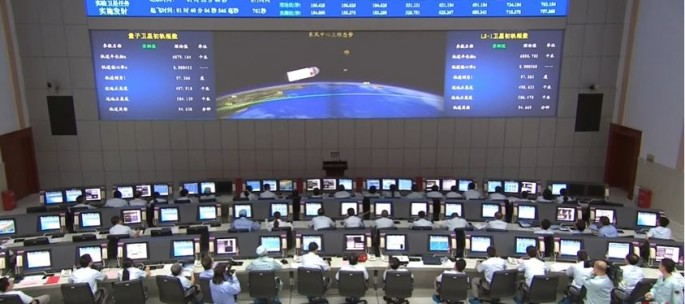 A glimpse of the Jiuquan Satellite Launch Center's control room during a rocket launch.