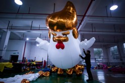 A worker inflates a giant chicken resembling Donald Trump in a factory in Jiaxing, Zhejiang Province, on Jan. 6, 2017.