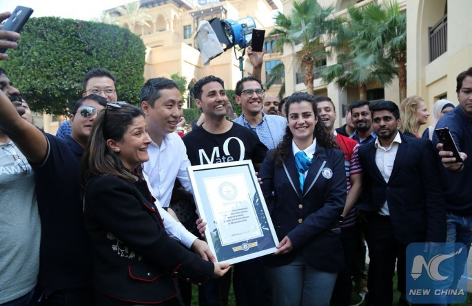 Huawei employees pose with Guinness World Record officials after breaking the record for most selfies at Dubai, U.A.E., on Jan. 10, 2017.