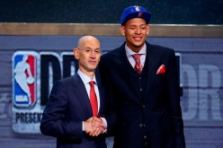 Isaiah Austin of Baylor (R) shakes hands with NBA Commissioner Adam Silver as he is honored on stage during the 2014 NBA Draft at Barclays Center on June 26, 2014 in the Brooklyn borough of New York City.