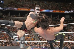 Finn Balor lands a heavy strike against Seth Rollins during their SummerSlam matchup for the inaugural WWE Universal Championship title.