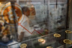 A man walks past a bitcoin exchange facility in Hong Kong.