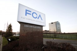 The Fiat Chrysler Automobiles (FCA) Group sign is shown at the Chrysler Group headquarters May 6, 2014 in Auburn Hills, Michigan.